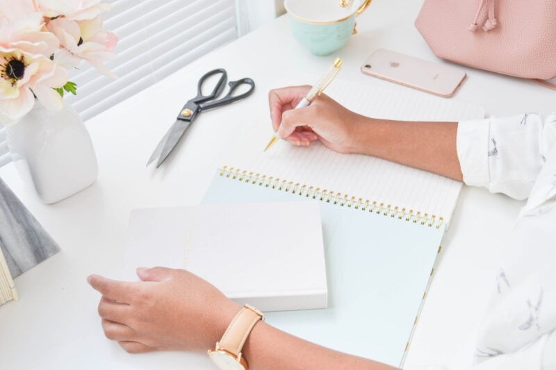 woman writing a to-don't list