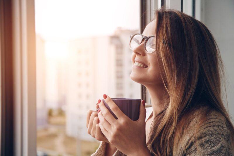 woman relaxing enjoying coffee