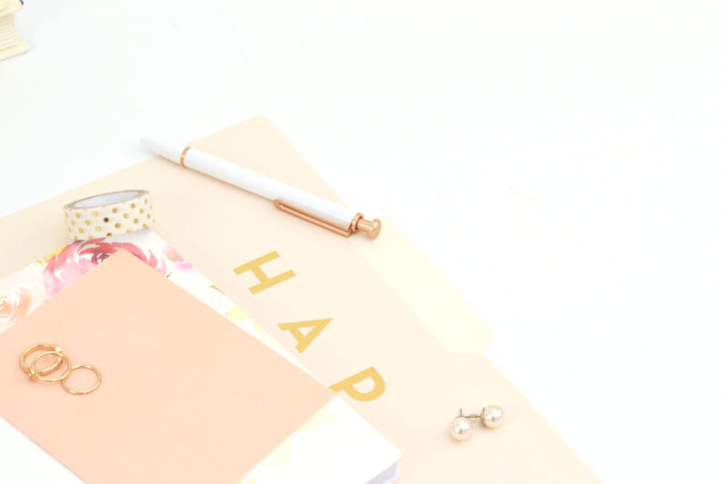 gold folders and pens