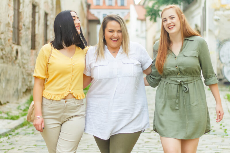 Woman hiding depression with friends
